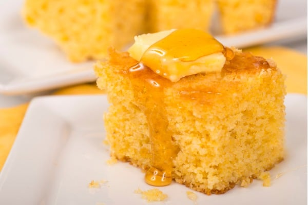 Putting honey on cornbread