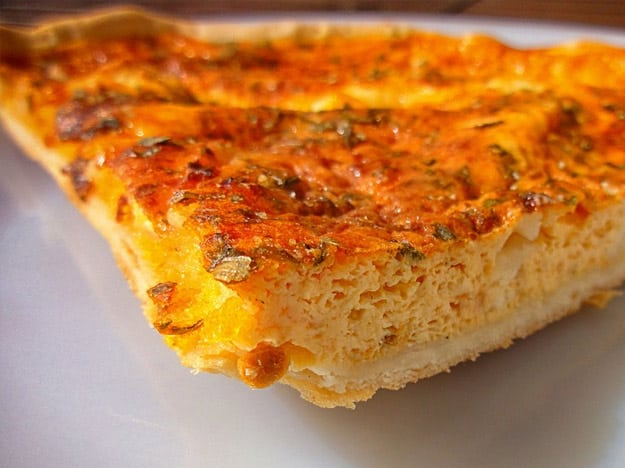 Piece of quiche that is perfectly browned