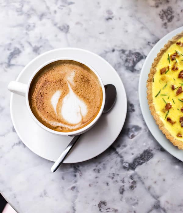 Coffee served with fresh Quiche Lorraine
