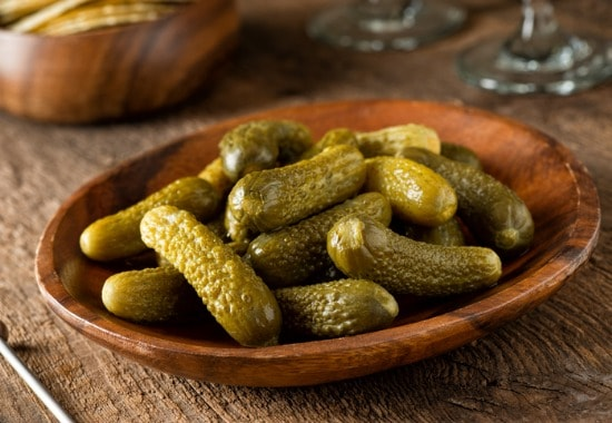 Dill pickles in side dish