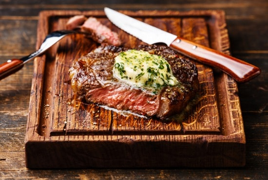 Herb button topping steak