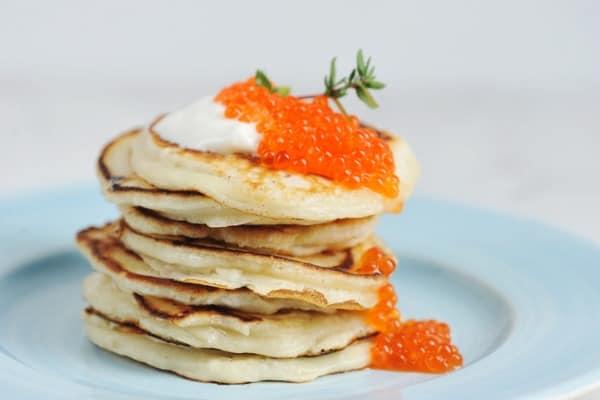 Red caviar on pancakes