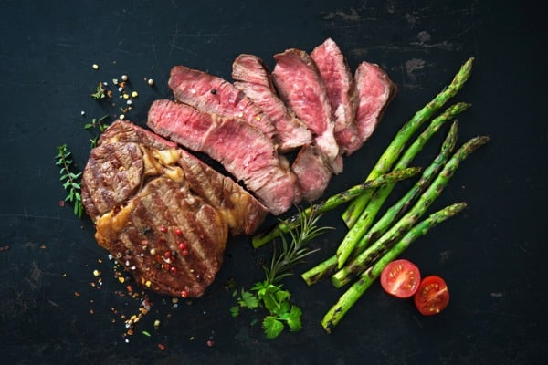 grilled piece of succulent steak and asparagus