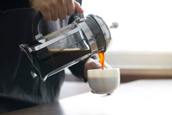 pouring coffee from french press coffee