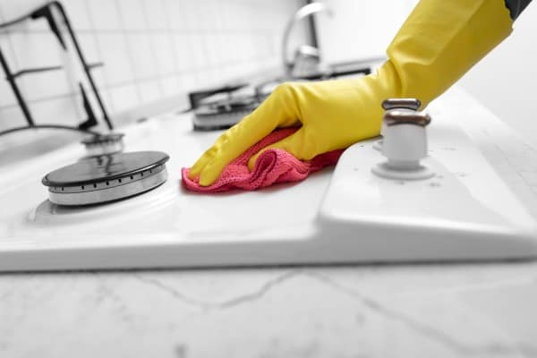 hand cleans countertop