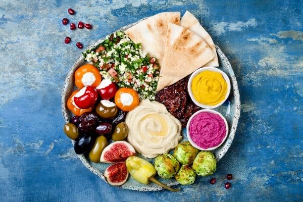 middle eastern meze platter with green falafel pita