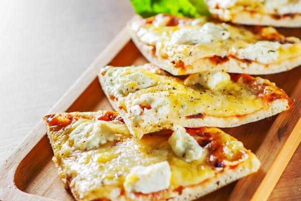sliced pizza with mozzarella cheese tomatoes pepper spices