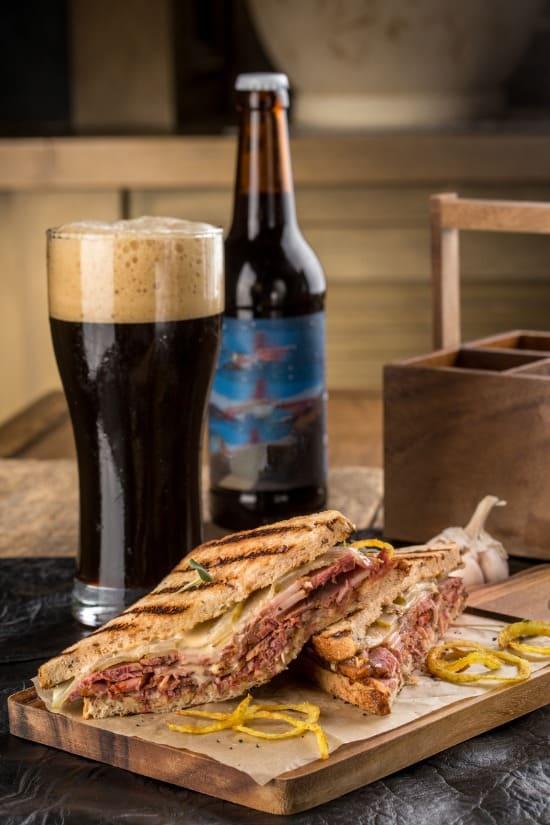 grilled reuben sandwich with dark beer