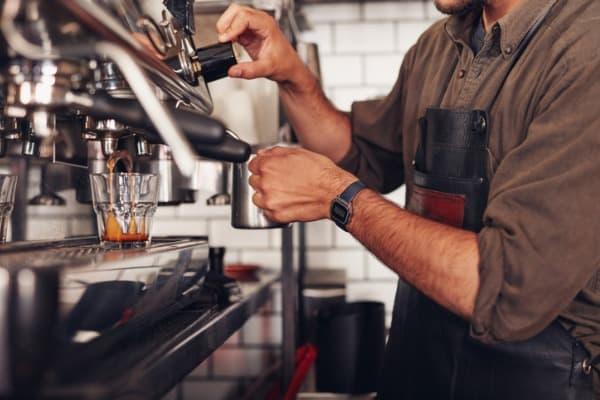 barista-making-coffee-using-a-coffee-maker