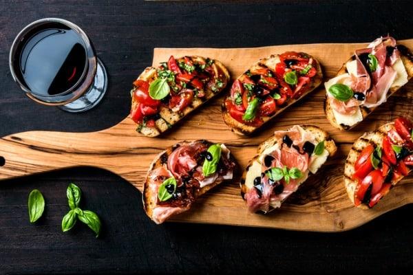 brushetta set and glass of red wine small sandwiches