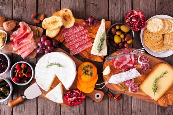 charcuterie boards of assorted meats cheeses and appetizers top view