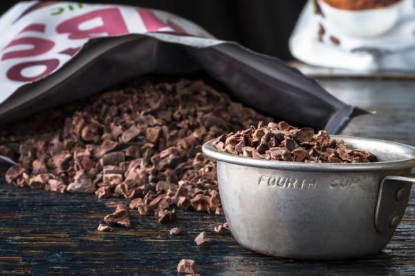 cocoa nibs in a measuring cup