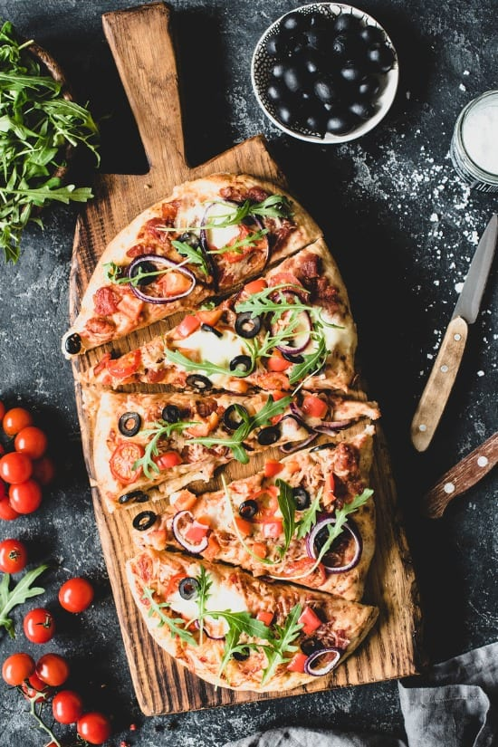 flatbread-pizza-garnished-with-fresh-arugula