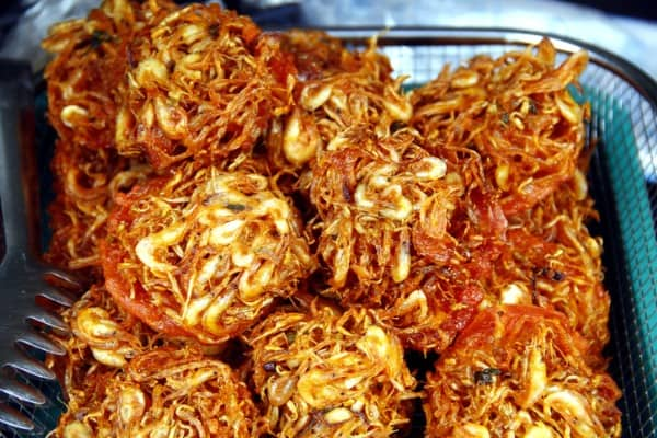 freshly cooked filipino food called okoy or filipino shrimp fritters