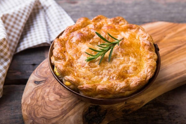 individual chicken pot pie with puff pastry crust top view