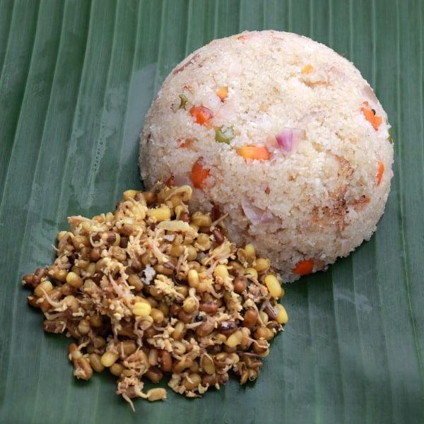 kerala breakfast cuisine upma with green gram masala on banana leaf