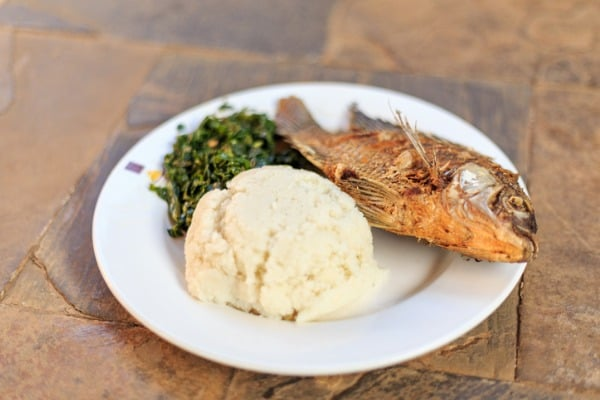 traditional african food ugali fish and greens