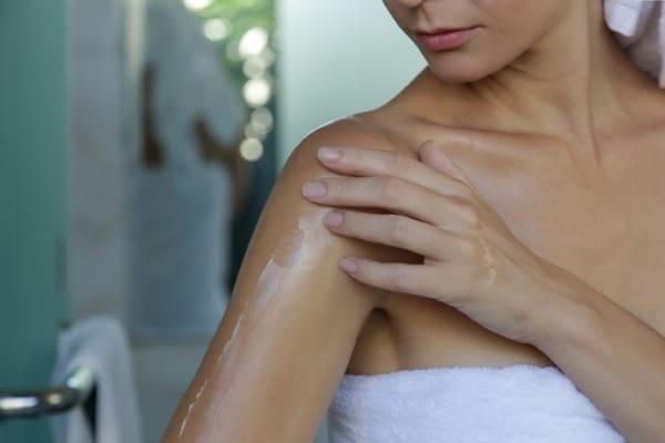 woman applying essential oils