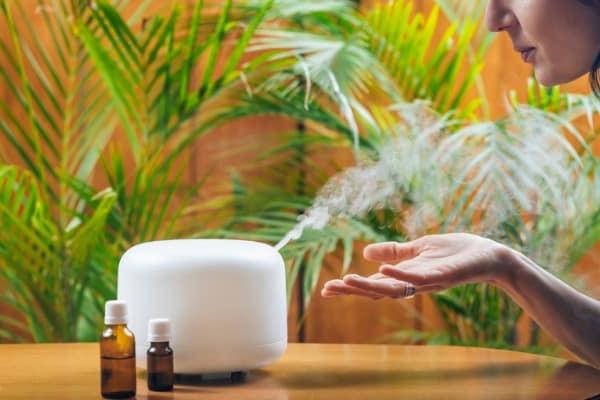 woman enjoying essential oils