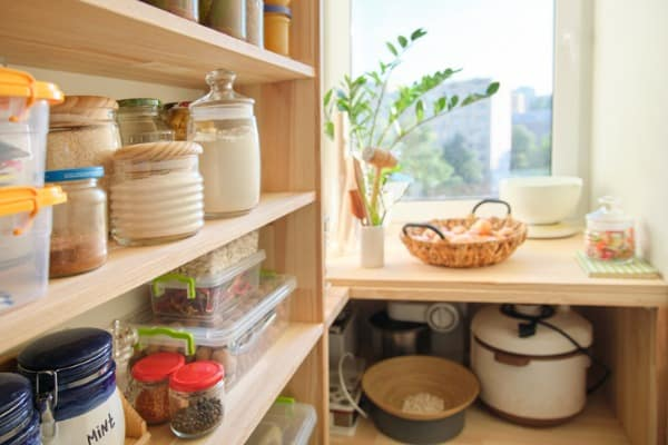 wooden-shelves-with-food-and-utensils-kitchen-appliances